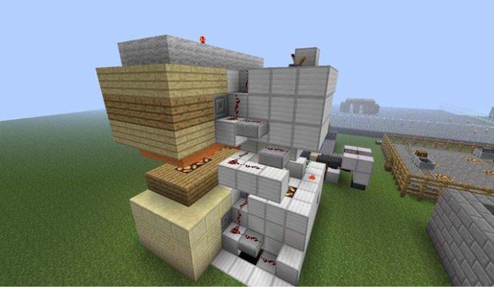 Vue du coté arrière droit de l'ascenseur à blocs de commandes. on peut voir que le fil de redstone