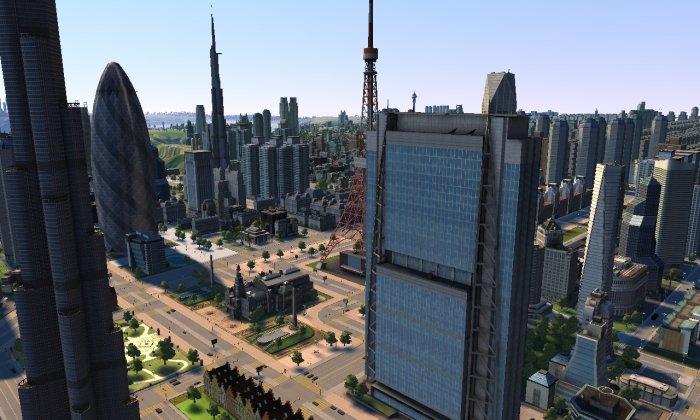 """La tour """"cornichon"""" à gauche de la mairie"""