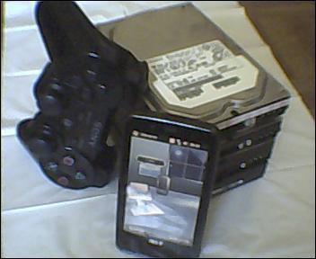 ma dual-schock, mon Acer F900 et mes HDD SATA pour mes jeux