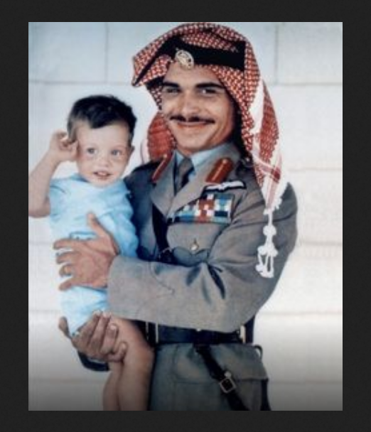 King Hussein holding his first son, prince Abdullah