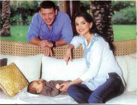 King Abdullah II with his wife and their last born.
