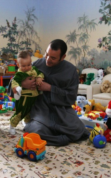 King Mohammed VI playing with his son