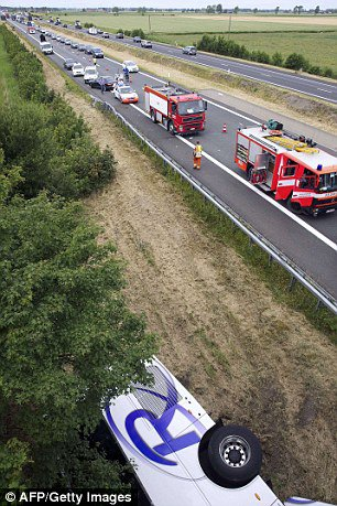 British coach carrying 30 children crashes in Belgium killing the driver
