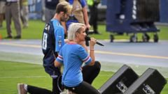 Singer of national anthem at NFL game takes a knee