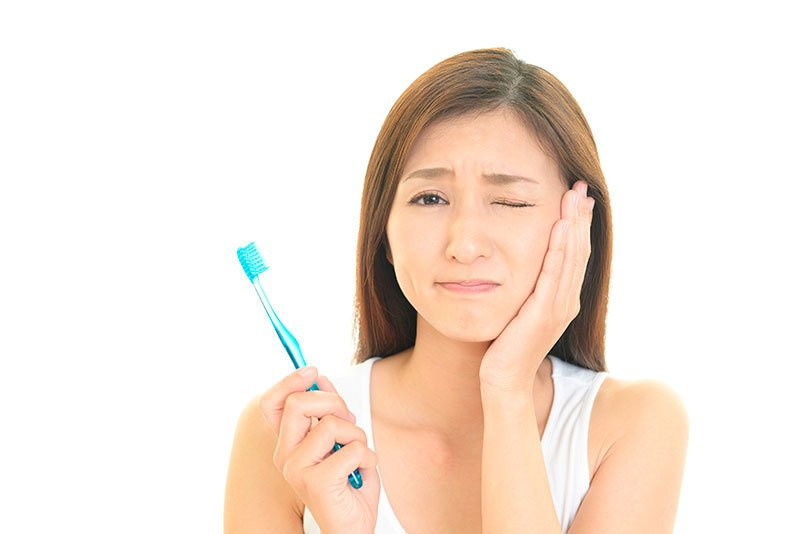 sintomas de problemas na ATM - Vue Odonto
