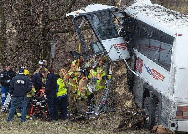 Coach, driver die in lacrosse team's bus crash