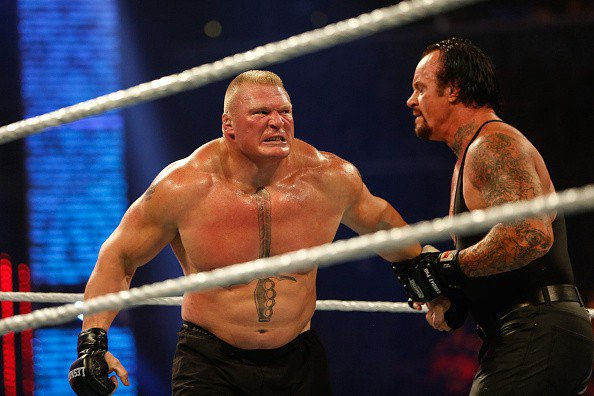 WWE Under Taker and Gold Berg and Brock Lesnar
