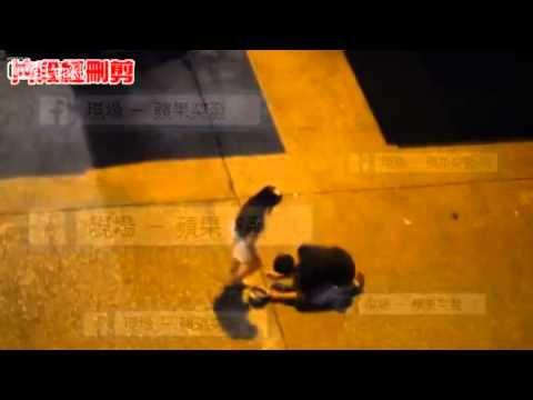 HongKong girl kicking and beating a man begging for mercy