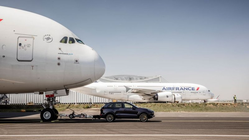 Porsche Cayenne pulling a monstrous Airbus A380 plane