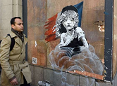 London builders cover up Banksy mural against France
