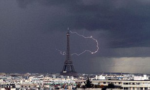 P for Paris: Ribbon of lightning turns the Eiffel Tower into a letter