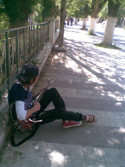 En Mode Guitarist De Rue