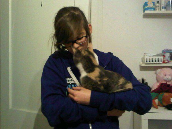Naomie's cat kissing me. $: