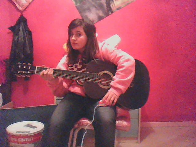 moi avec ma guitare