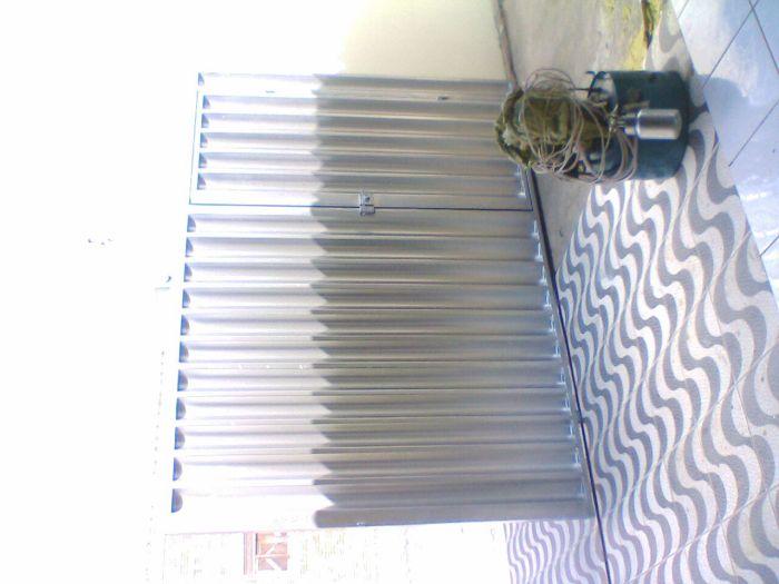 olha so este portão pintei com pistola